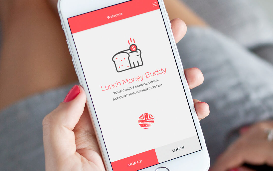 woman holding iPhone with Lunch Money Buddy app welcome screen displayed